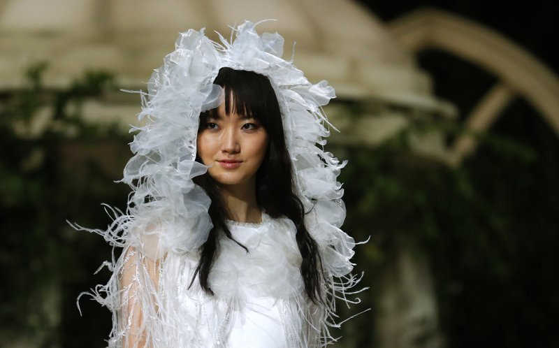 FILE - In this April 23, 2018, file photo, a model wears a creation from Pronovias during Barcelona Bridal fashion week in Barcelona, Spain. (AP Photo/Manu Fernandez, File)