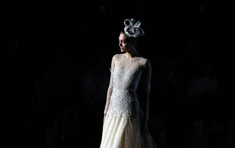 FILE - In this April 24, 2018, file photo, a model wears a creation from Jesus Peiro during Barcelona Bridal fashion week in Barcelona, Spain. (AP Photo/Manu Fernandez, File)