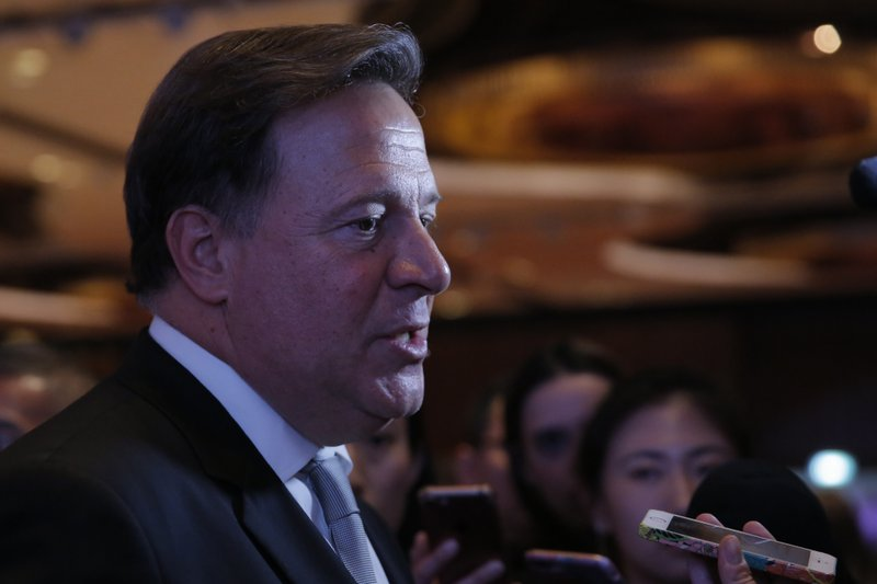 Panama President Juan Carlos Varela Rodríguez speaks to the media after a conference on the Panama invest in Hong Kong, Tuesday, April 2, 2019. (AP Photo/Kin Cheung)
