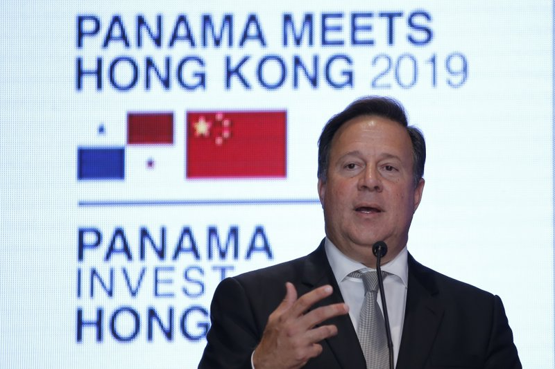Panama President Juan Carlos Varela Rodríguez delivers a speech at a conference on the Panama invest in Hong Kong, Tuesday, April 2, 2019. (AP Photo/Kin Cheung)