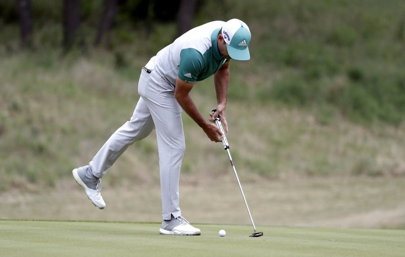 Sergio Garcia reaches to pick up his ball after he missed his second putt on No. 7 during quarterfinal play against Matt Kuchar at the Dell Technologies Match Play Championship golf tournament, Saturday, March 30, 2019, in Austin, Texas. (AP Photo/Eric Gay)