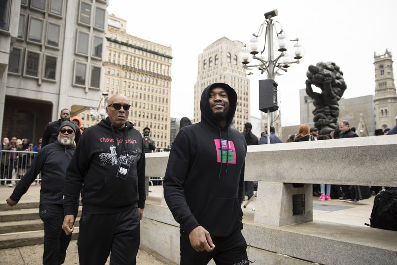 Recording artist Meek Mill departs from a gathering held to push for drastic changes to Pennsylvania's probation system, in Philadelphia, Tuesday, April 2, 2019. (AP Photo/Matt Rourke)