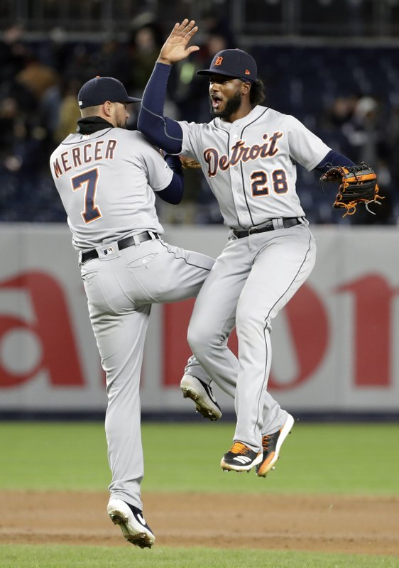 Detroit Tigers shortstop Jordy Mercer (7) and outfielder Niko Goodrum (28) celebrate after defeating the New York Yankees in a baseball game against the New York Yankees, Tuesday, April 2, 2019, in New York. (AP Photo/Kathy Willens)