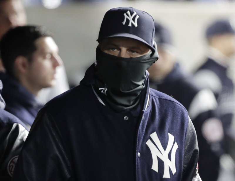 New York Yankees manager Aaron Boone wears a balaclava to keep warm during a baseball game against the Detroit Tigers, Tuesday, April 2, 2019, in New York. (AP Photo/Kathy Willens)