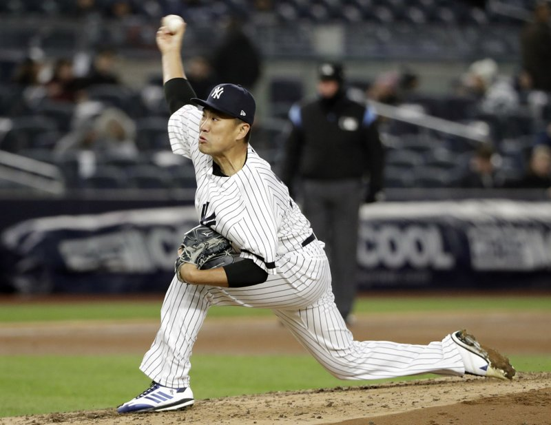 New York Yankees starting pitcher Masahiro Tanaka (19) winds up during the fourth inning of a baseball game against the Detroit Tigers, Tuesday, April 2, 2019, in New York. (AP Photo/Kathy Willens)