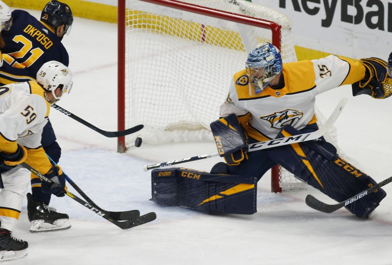 Buffalo Sabres forward Kyle Okposo (21) puts the puck past Nashville Predators goalie Pekka Rinne (35) during the first period of an NHL hockey game Tuesday, April 2, 2019, in Buffalo, N. (AP Photo/Jeffrey T. Barnes)