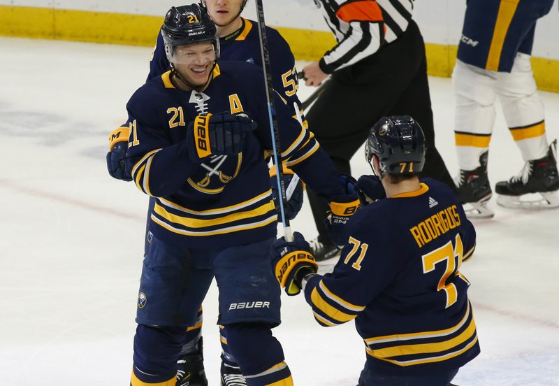 Buffalo Sabres forwards Kyle Okposo (21) and Evan Rodrigues (71) celebrate a goal during the first period of an NHL hockey game against the Nashville Predators Tuesday, April 2, 2019, in Buffalo, N. (AP Photo/Jeffrey T. Barnes)