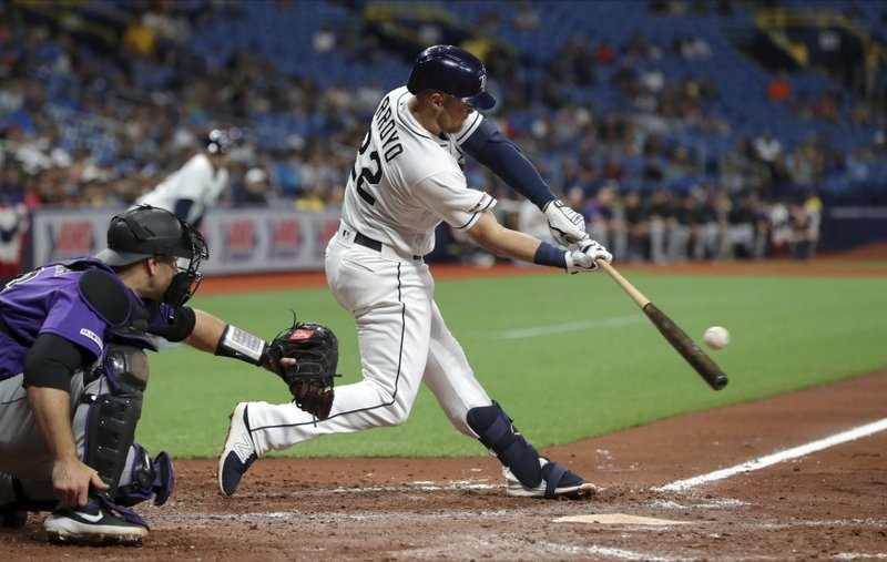 Tampa Bay Rays' Christian Arroyo singles scoring Kevin Kiermaier during the sixth inning of a baseball game against the Colorado Rockies Tuesday, April 2, 2019, in St. (AP Photo/Mike Carlson)