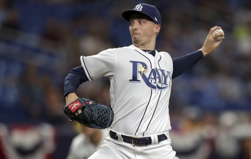 Tampa Bay Rays starting pitcher Blake Snell throws during the first inning of a baseball game against the Colorado Rockies Tuesday, April 2, 2019, in St. (AP Photo/Mike Carlson)