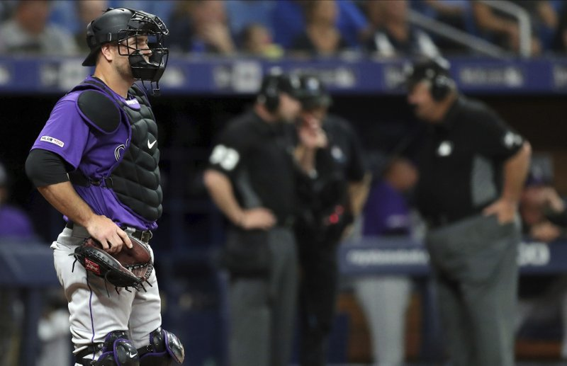 Colorado Rockies catcher Chris Iannetta waits as umpires review a force play at the plate during the first inning of a baseball game against the Tampa Bay Rays Tuesday, April 2, 2019, in St. (AP Photo/Mike Carlson)