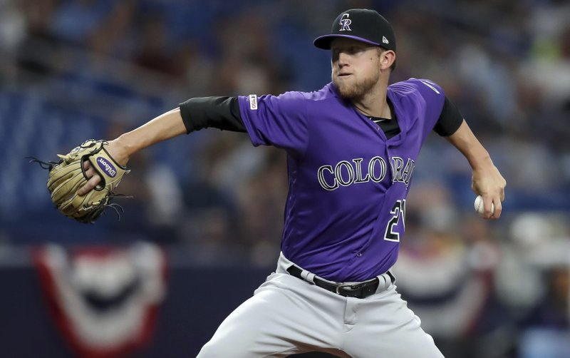 Colorado Rockies starting pitcher Kyle Freeland throws during the first inning of a baseball game against the Tampa Bay Rays Tuesday, April 2, 2019, in St. (AP Photo/Mike Carlson)