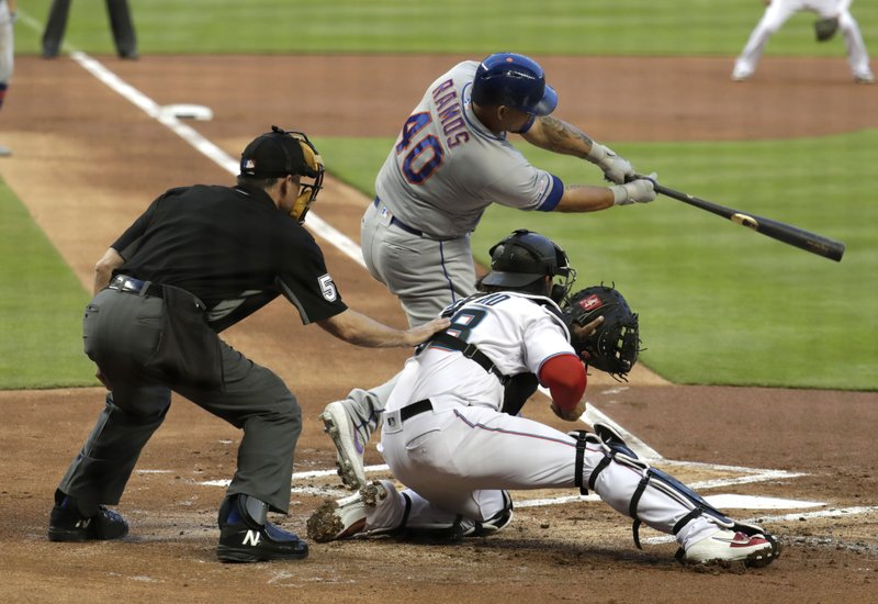 New York Mets' Wilson Ramos (40) hits an RBI-single to score Brandon Nimmo during the first inning of a baseball game, Tuesday, April 2, 2019, in Miami. (AP Photo/Lynne Sladky)