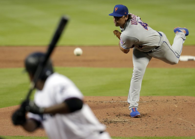 New York Mets starting pitcher Jason Vargas throws to Miami Marlins' Curtis Granderson during the first inning of a baseball game, Tuesday, April 2, 2019, in Miami. (AP Photo/Lynne Sladky)