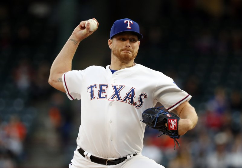Texas Rangers starting pitcher Shelby Miller (19) throws to the Houston Astros in the first inning of a baseball game in Arlington, Texas, Tuesday, April 2, 2019. (AP Photo/Tony Gutierrez)