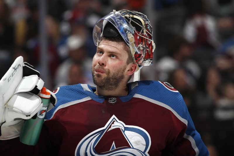 Colorado Avalanche goaltender Semyon Varlamov takes a drink during a timeout against the Edmonton Oilers in the second period of an NHL hockey game Tuesday, April 2, 2019, in Denver. (AP Photo/David Zalubowski)