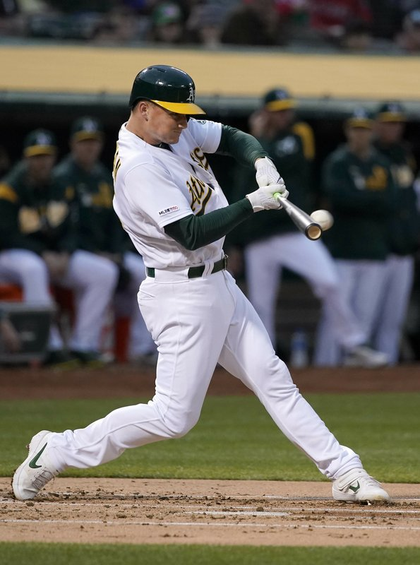 Oakland Athletics' Matt Chapman (26) hits a solo home run against Boston Red Sox pitcher Chris Sale during the first inning of a baseball game in Oakland, Calif. (AP Photo/Tony Avelar)