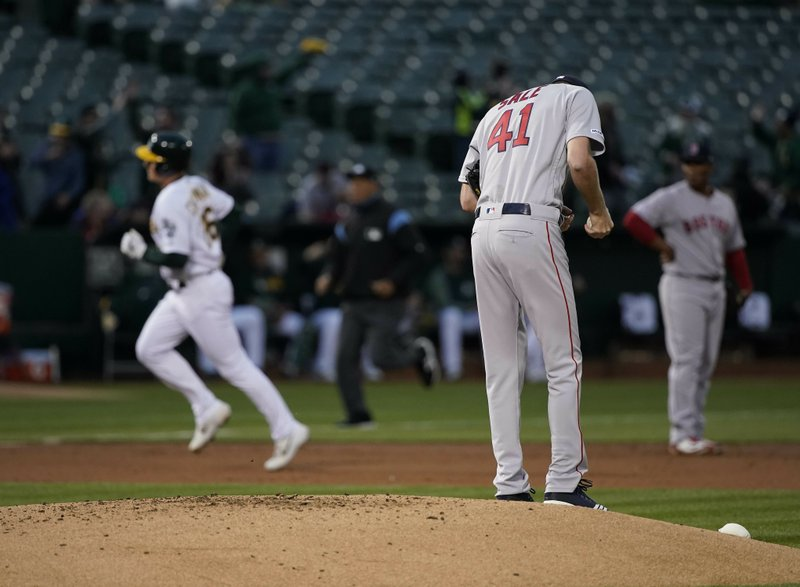 Boston Red Sox pitcher Chris Sale (41) stands on the mound after allowing a solo home run to Oakland Athletics' Matt Chapman, left, during the first inning of a baseball game in Oakland, Calif. (AP Photo/Tony Avelar)