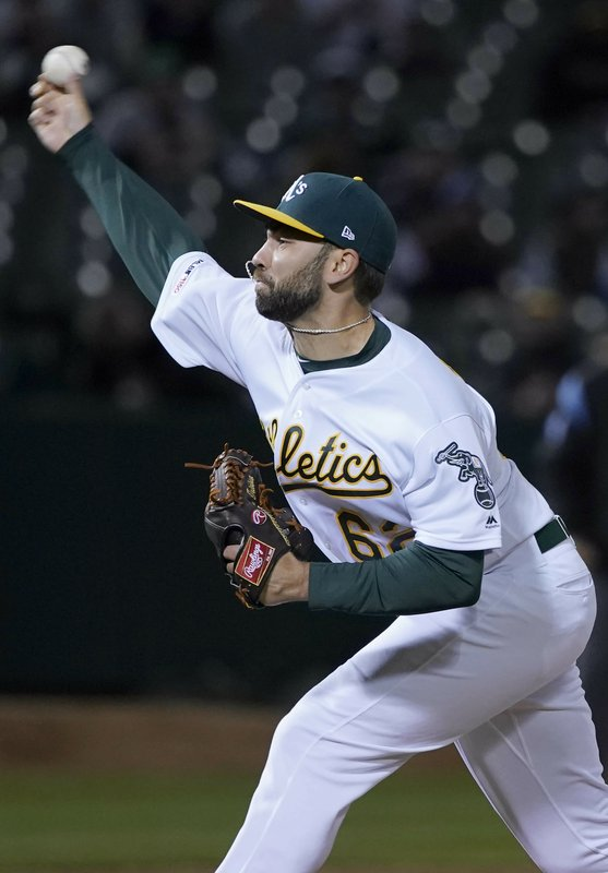 Oakland Athletics relief pitcher Lou Trivino (62) throws against the Boston Red Sox during the eighth inning of a baseball game in Oakland, Calif. (AP Photo/Tony Avelar)