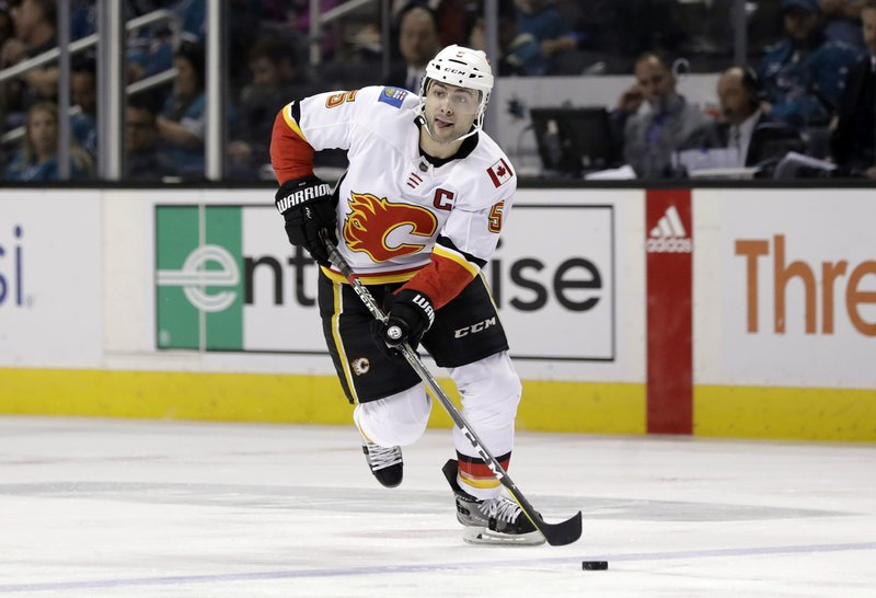 File-This March 24, 2019, file photo shows Calgary Flames' Mark Giordano (5) during the first period of an NHL hockey game against the San Jose Sharks in San Jose, Calif. (AP Photo/Marcio Jose Sanchez, File)