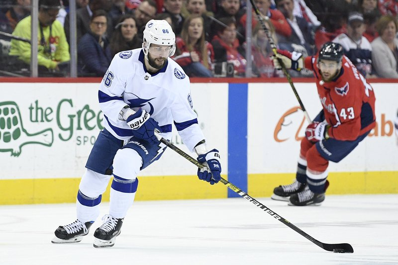 File-This March 20, 2019, file photo shows Tampa Bay Lightning right wing Nikita Kucherov (86), of Russia, skating with the puck during the first period of an NHL hockey game past Washington Capitals right wing Tom Wilson (43), in Washington. (AP Photo/Nick Wass, File)