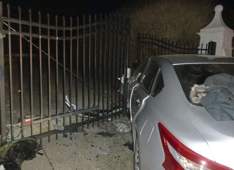 This Tuesday, April 2, 2019 photo released by the Hopkinton, R.I., Police Department shows a car after it crashed into the gates of singer Taylor Swift's beachfront home in Westerly, R. (Hopkinton Police Department via AP)