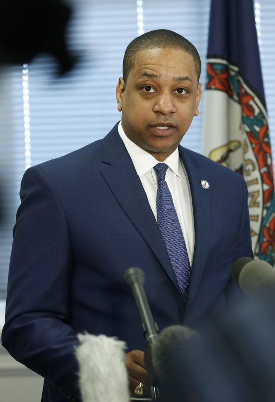 Virginia Lt. Gov. Justin Fairfax addresses the media during a news conference in his office at the Capitol in Richmond, Va. (AP Photo/Steve Helber)