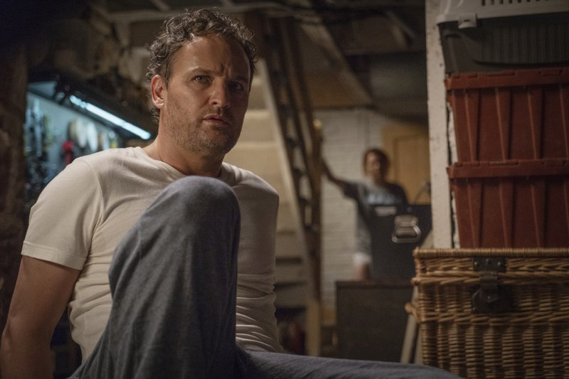 This image released by Paramount Pictures shows Jason Clarke as Louis, left, and Amy Seimetz in a scene from