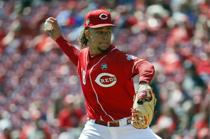 Cincinnati Reds starting pitcher Luis Castillo throws in the first inning of a baseball game against the Milwaukee Brewers, Wednesday, April 3, 2019, in Cincinnati. (AP Photo/John Minchillo)