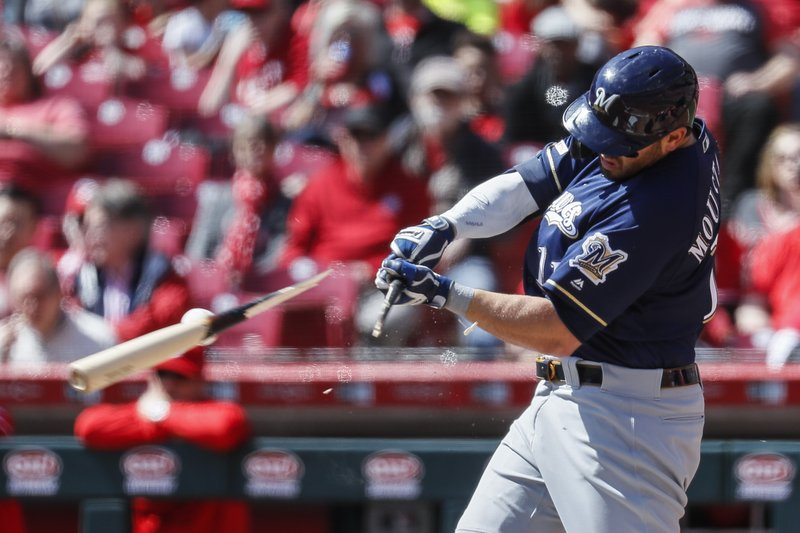 Milwaukee Brewers' Mike Moustakas breaks his bat on a pitch from Cincinnati Reds starting pitcher Luis Castillo in the second inning of a baseball game, Wednesday, April 3, 2019, in Cincinnati. (AP Photo/John Minchillo)