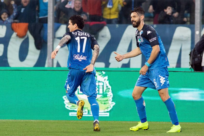 Empoli's Diego Farias, left, celebrates after scoring during the Serie A soccer match between Empoli and Napoli at Carlo Castellani stadium in Empoli, Italy, Wednesday, April 3, 2019. (Gianni Nucci/ANSA via AP)