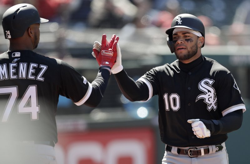 Chicago White Sox's Yoan Moncada (10) is congratulated by Eloy Jimenez (74) after Moncada scored in the fourth inning of a baseball game against the Cleveland Indians, Wednesday, April 3, 2019, in Cleveland. (AP Photo/Tony Dejak)