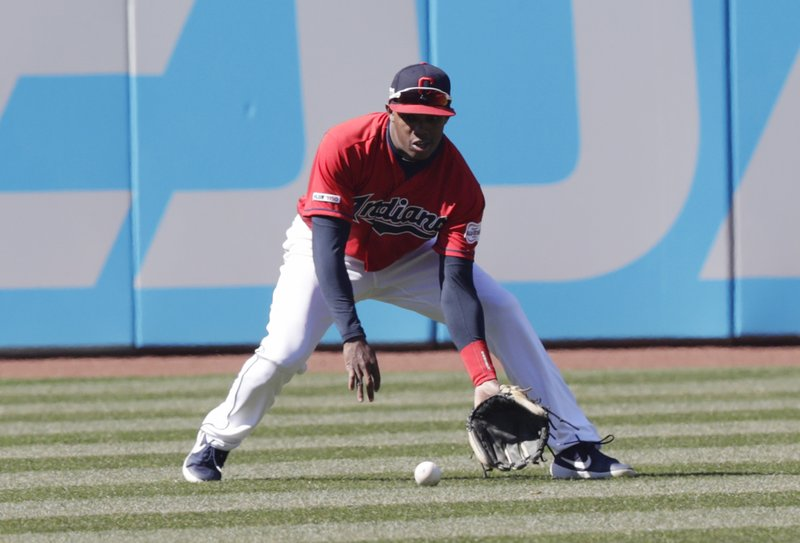 Cleveland Indians' Greg Allen fields a ball hit by Chicago White Sox's James McCann in the seventh inning of a baseball game, Wednesday, April 3, 2019, in Cleveland. (AP Photo/Tony Dejak)