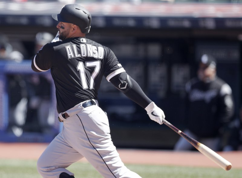 Chicago White Sox's Yonder Alonso watches his ball after hitting an RBI-single off Cleveland Indians starting pitcher Corey Kluber in the first inning of a baseball game, Wednesday, April 3, 2019, in Cleveland. (AP Photo/Tony Dejak)