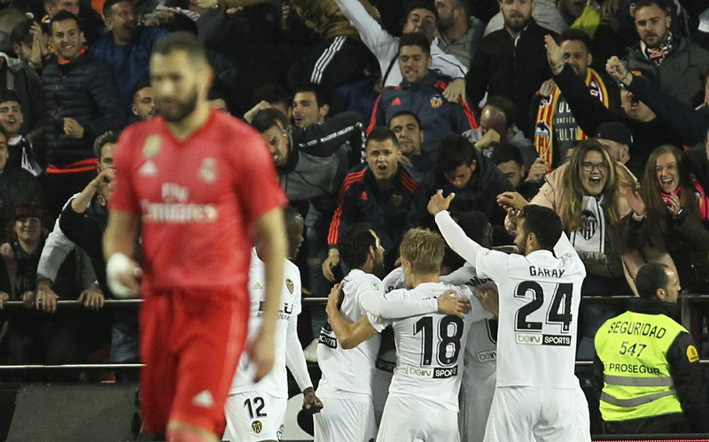 Valencia players celebrate the opening goal during the Spanish La Liga soccer match between Valencia and Real Madrid at the Mestalla Stadium in Valencia, Spain, Wednesday, April 3, 2019. (AP Photo/Alberto Saiz)