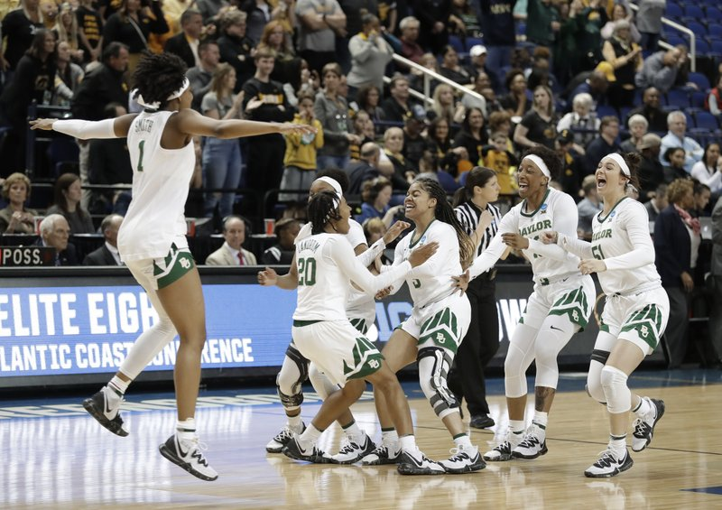 FILE - In this Monday, April 1, 2019, file photo, Baylor players celebrate their win over Iowa in a regional final in the NCAA women's college basketball tournament in Greensboro, N. (AP Photo/Chuck Burton, File)
