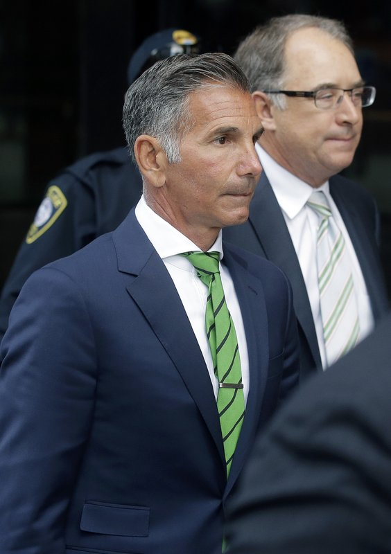 Clothing designer Mossimo Giannulli departs federal court in Boston on Wednesday, April 3, 2019, after facing charges in a nationwide college admissions bribery scandal. (AP Photo/Steven Senne)