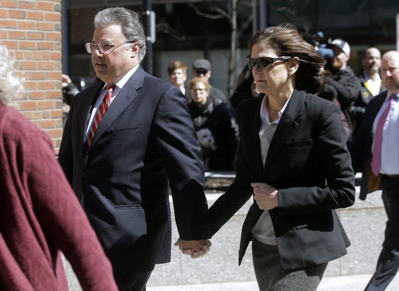 Manuel and Elizabeth Henriquez arrive at federal court in Boston on Wednesday, April 3, 2019, to face charges in a nationwide college admissions bribery scandal. (AP Photo/Steven Senne)