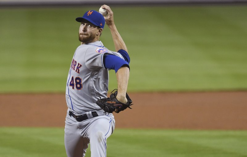 New York Mets' Jacob deGrom pitches against the Miami Marlins during the first inning of a baseball game Wednesday, April 3, 2019, in Miami. (AP Photo/Jim Rassol)