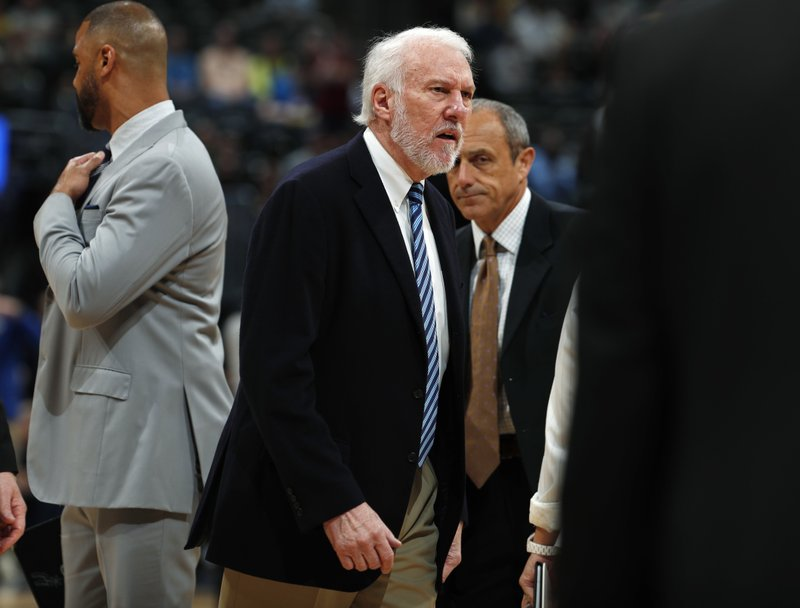 San Antonio Spurs head coach Gregg Popovich reacts after being ejected in the first half of an NBA basketball game against the Denver Nuggets Wednesday, April 3, 2019, in Denver. (AP Photo/David Zalubowski)