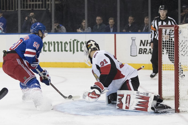 New York Rangers center Lias Andersson (50) scores a goal past Ottawa Senators goaltender Anders Nilsson (31) during the second period of an NHL hockey game, Wednesday, April 3, 2019, at Madison Square Garden in New York. (AP Photo/Mary Altaffer)