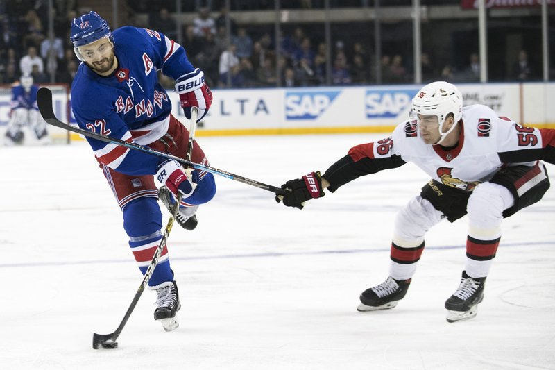 New York Rangers defenseman Kevin Shattenkirk (22) controls the puck skating against Ottawa Senators left wing Magnus Paajarvi (56) during the second period of an NHL hockey game, Wednesday, April 3, 2019, at Madison Square Garden in New York. (AP Photo/Mary Altaffer)