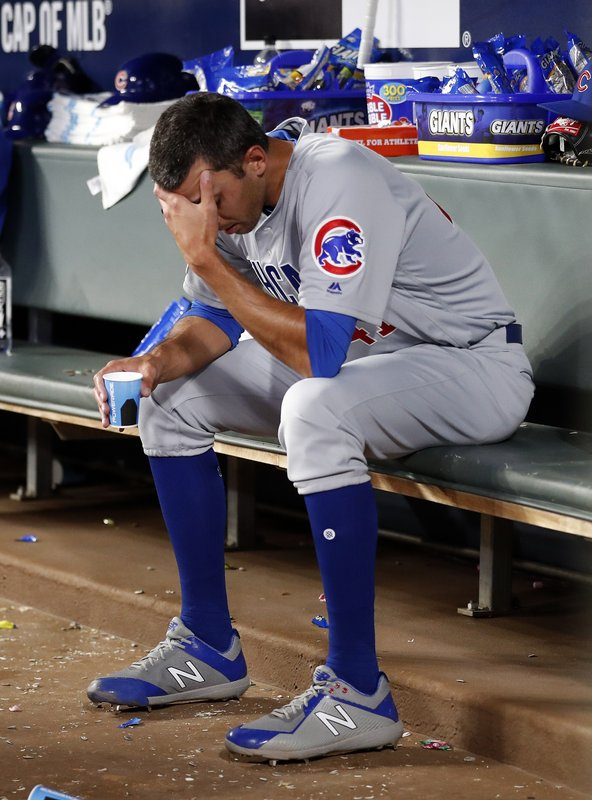 Chicago Cubs relief pitcher Steve Cishek sits on the bench after being replaced in the eighth inning of the team's baseball game against the Atlanta Braves on Wednesday, April 3, 2019, in Atlanta. (AP Photo/John Bazemore)
