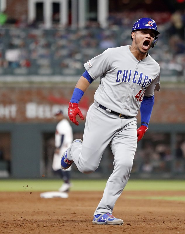 Chicago Cubs' Willson Contreras reacts as he rounds the bases after hitting a two-run home run in the sixth inning of baseball game against the Atlanta Braves Wednesday, April 3, 2019, in Atlanta. (AP Photo/John Bazemore)