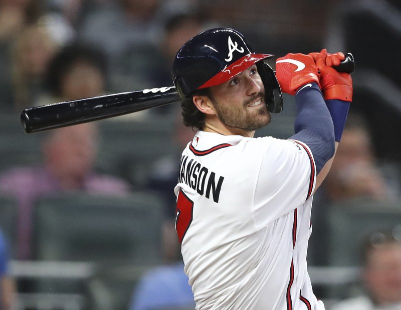 Atlanta Braves shortstop Dansby Swanson hits a solo home run against the Chicago Cubs during the third inning of a baseball game, Wednesday, April 3, 2019 in Atlanta. (Curtis Compton/Atlanta Journal-Constitution via AP)