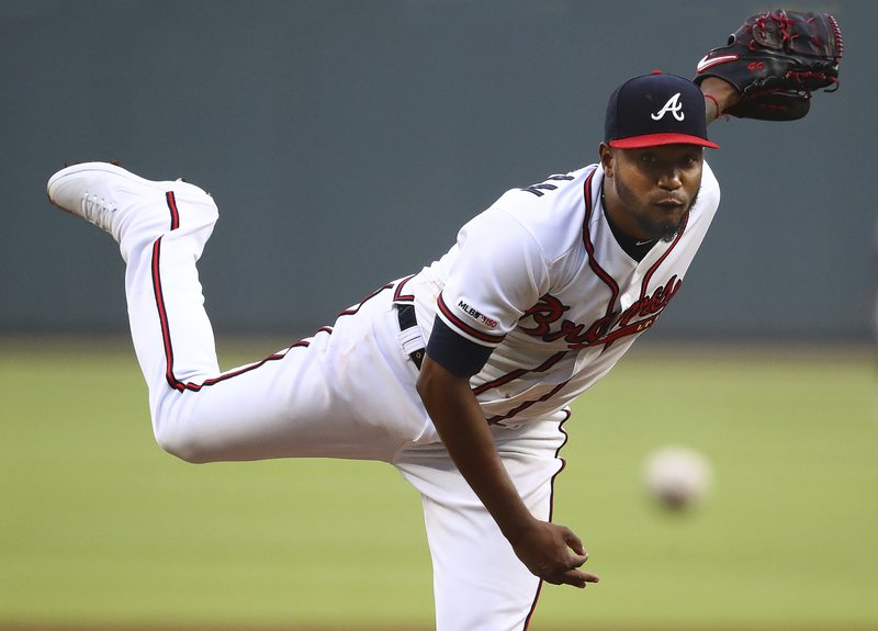 Atlanta Braves pitcher Julio Teheran delivers a pitch against the Chicago Cubs during the first inning of a baseball game, Wednesday, April 3, 2019 in Atlanta. (Curtis Compton/Atlanta Journal-Constitution via AP)