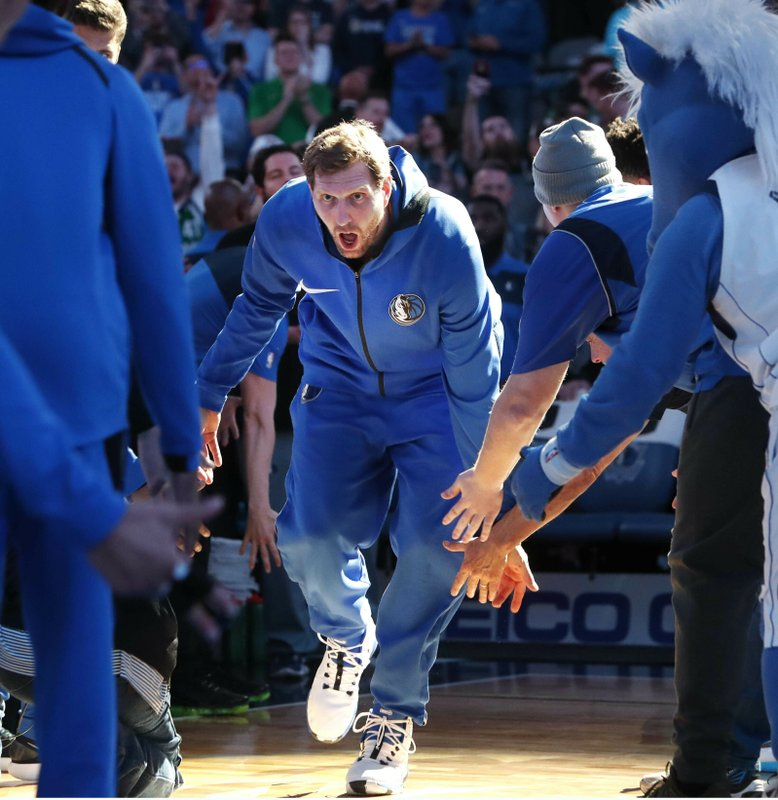 Dallas Mavericks forward Dirk Nowitzki runs onto the court during team introductions for an NBA basketball game against the Minnesota Timberwolves in Dallas, Wednesday, April 3, 2019. (AP Photo/LM Otero)