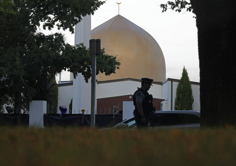 FILE - In this March 17, 2019, file photo, a police officer stands guard in front of the Al Noor mosque in Christchurch, New Zealand. (AP Photo/Vincent Yu, File)