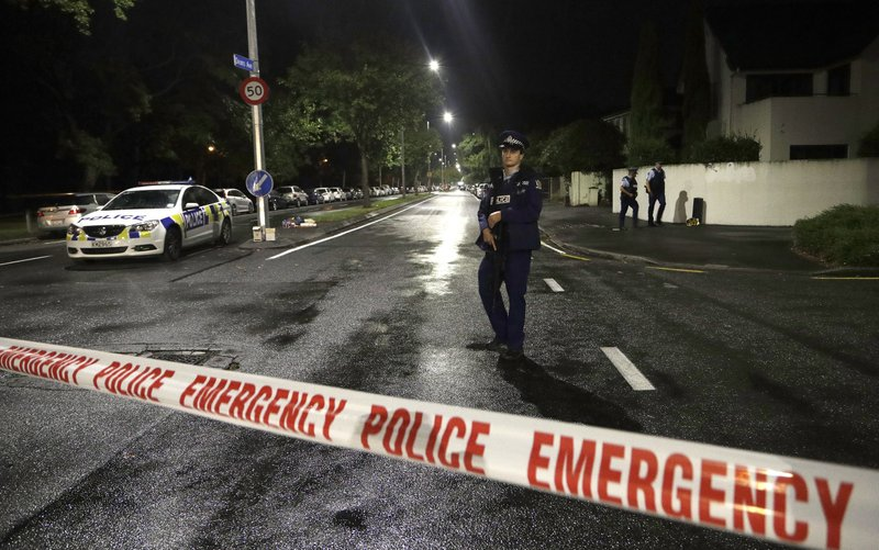 FILE - In this March 15, 2019, photo, a police officer patrols at a cordon near a mosque in central Christchurch, New Zealand. (AP Photo/Mark Baker, File)