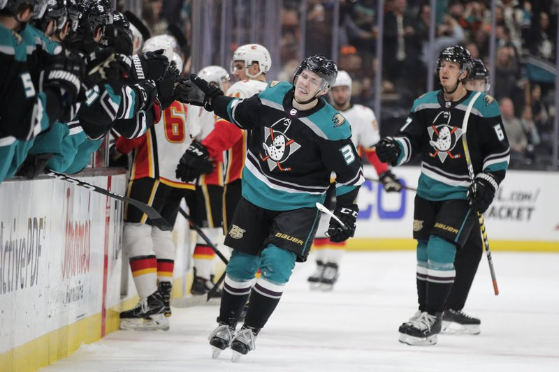 Anaheim Ducks' Sam Steel, center, celebrates his goal with teammates during the first period of an NHL hockey game against the Calgary Flames on Wednesday, April 3, 2019, in Anaheim, Calif. (AP Photo/Jae C. Hong)