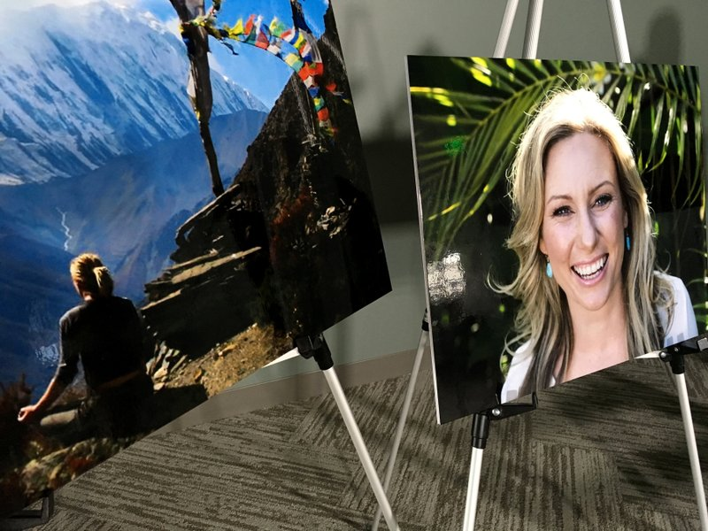 FILE - In this July 23, 2018, file photo, posters of Justine Ruszczyk Damond are displayed at a news conference by attorneys for her family in Minneapolis. (AP Photo/Amy Forliti, File)